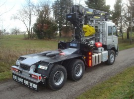 Forestry equipment for semi-trailer Volvo 6x4 + crane Tajfun-Liv 300K99