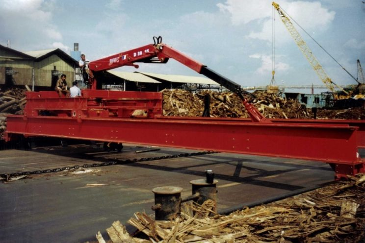 Crane on conveyor or barge